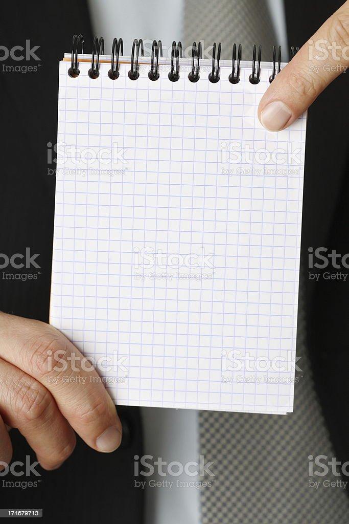 Businessman holding notepad royalty-free stock photo