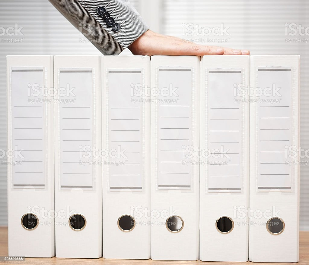 businessman holding organized documentation in binders, accounting services  and bookkeeping stock photo