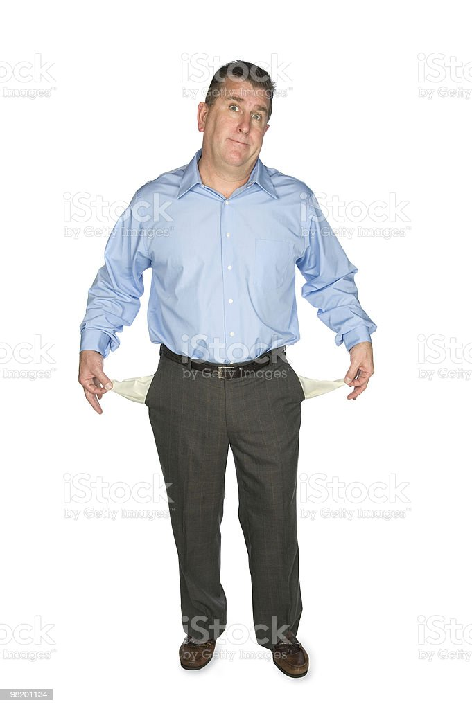 Businessman holding out empty pockets royalty-free stock photo