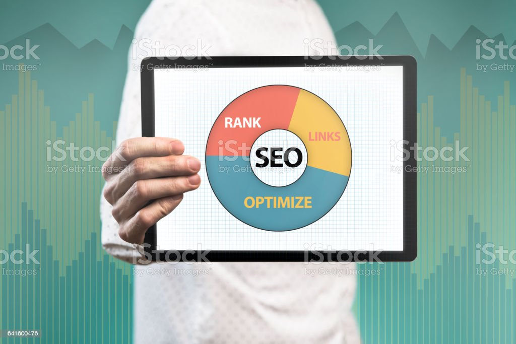 Businessman holding pad with SEO chart (Click for more) stock photo