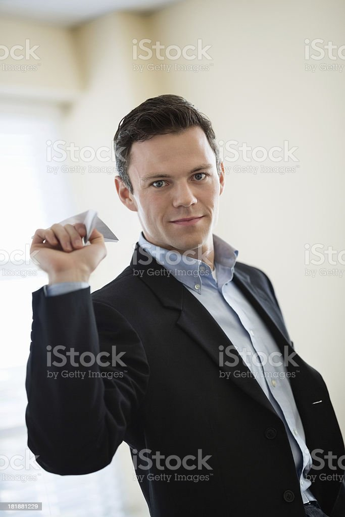 Businessman Holding Paper Plane In Office royalty-free stock photo