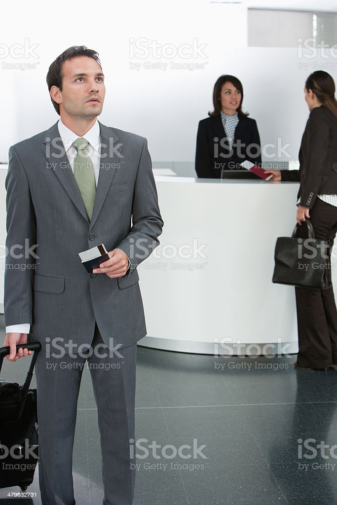 Businessman holding passport and airline ticket stock photo