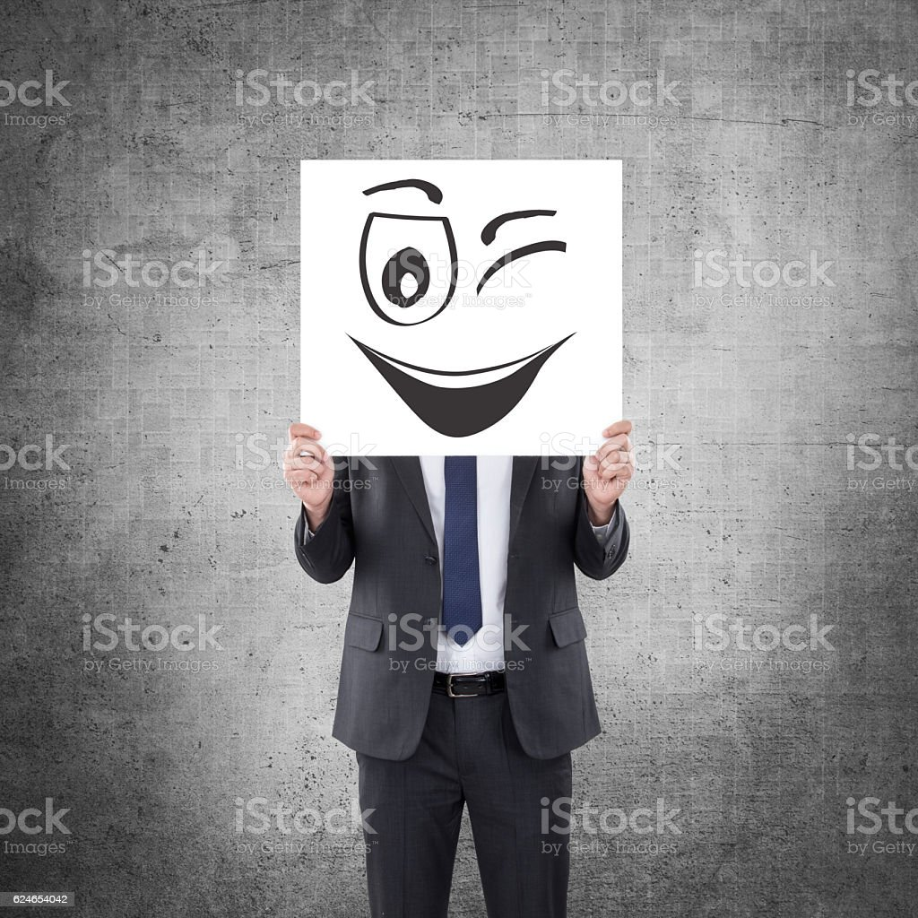 Businessman holding placard with smile winking gesture. stock photo