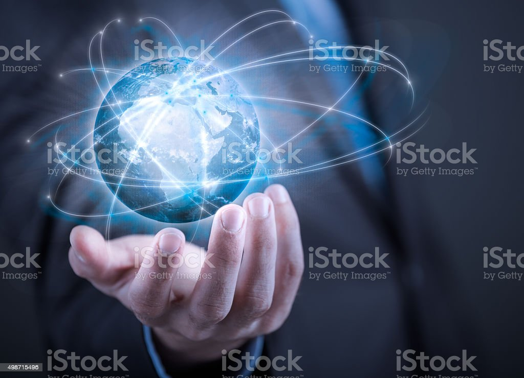 Businessman holding planet Earth in palm stock photo