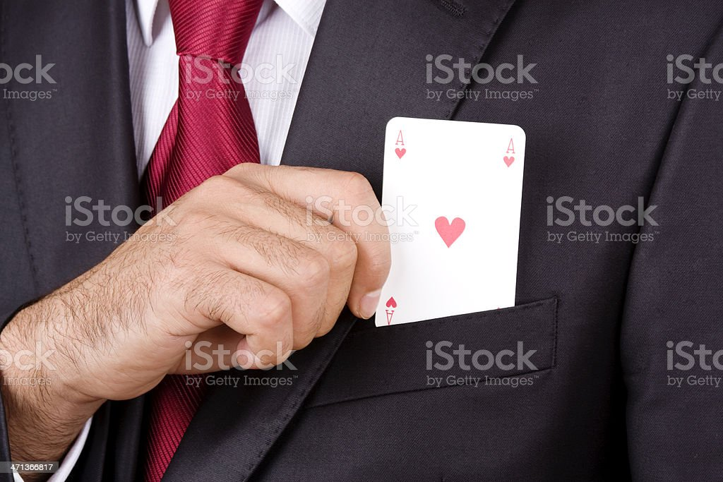 Businessman holding play card stock photo