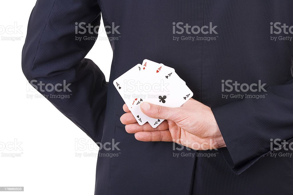 Businessman holding playing cards behind his back. royalty-free stock photo