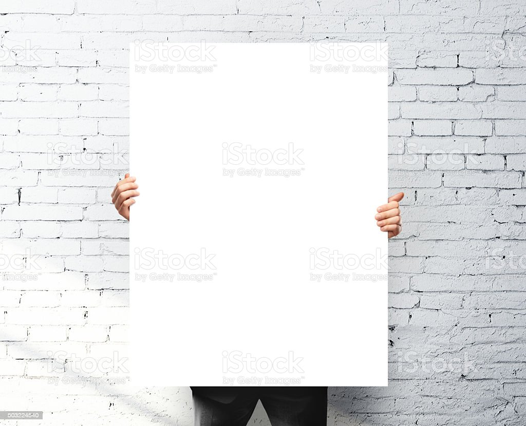 businessman holding poster stock photo