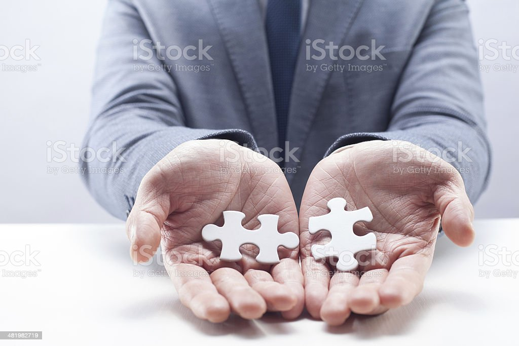 Businessman Holding Puzzles royalty-free stock photo