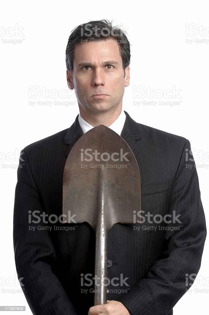 Businessman Holding Shovel Isolated on White Background stock photo