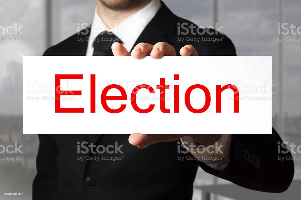 businessman holding sign election stock photo