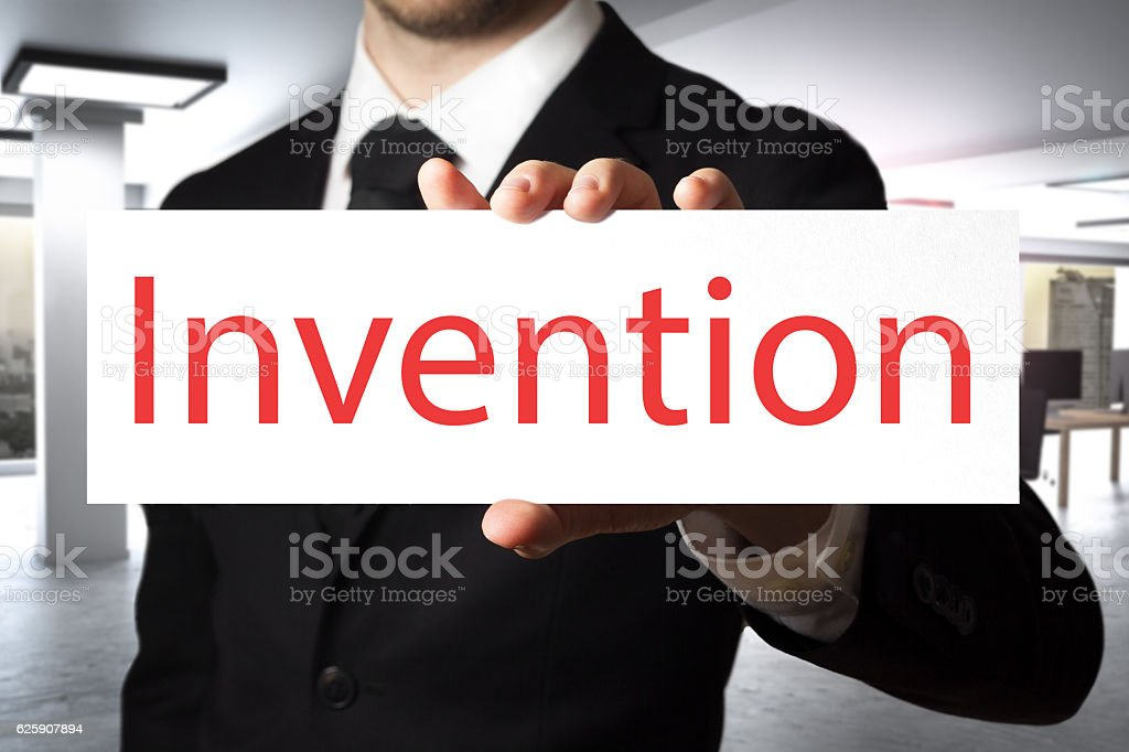 businessman holding sign invention stock photo