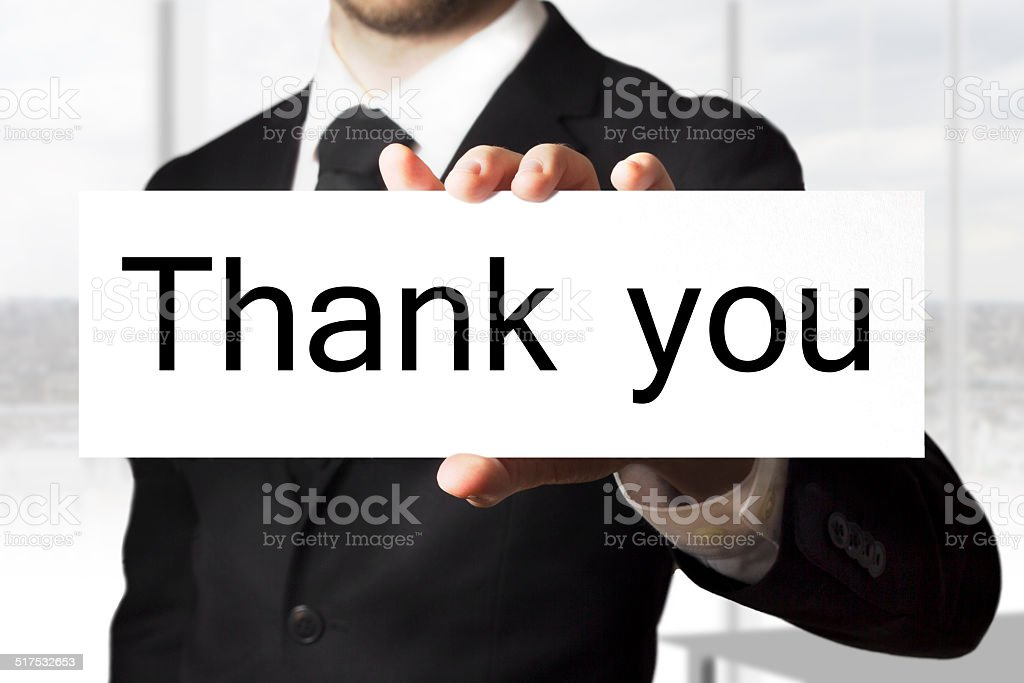businessman holding sign thank you stock photo