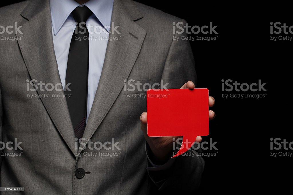 Businessman Holding Speech Bubble stock photo