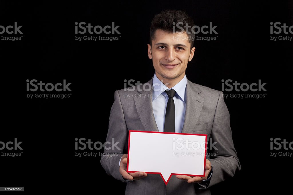 Businessman Holding Speech Bubble royalty-free stock photo