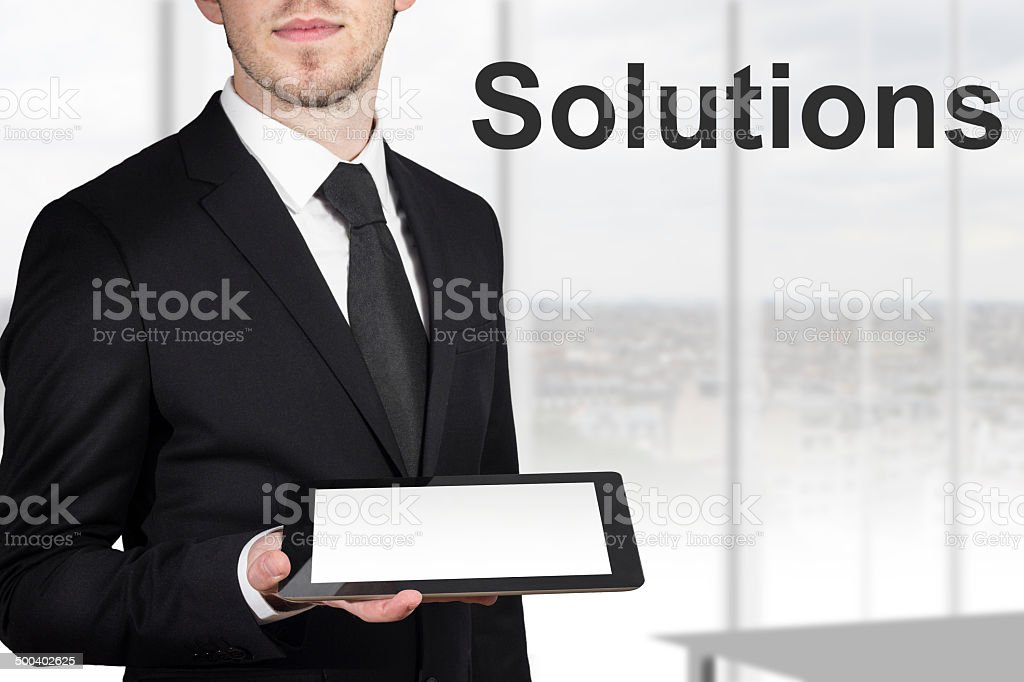 businessman holding tablet pc solutions royalty-free stock photo