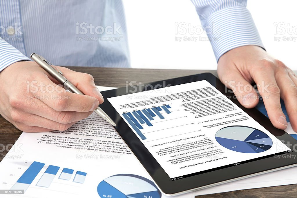 businessman holding tablet  with graphics a screen royalty-free stock photo