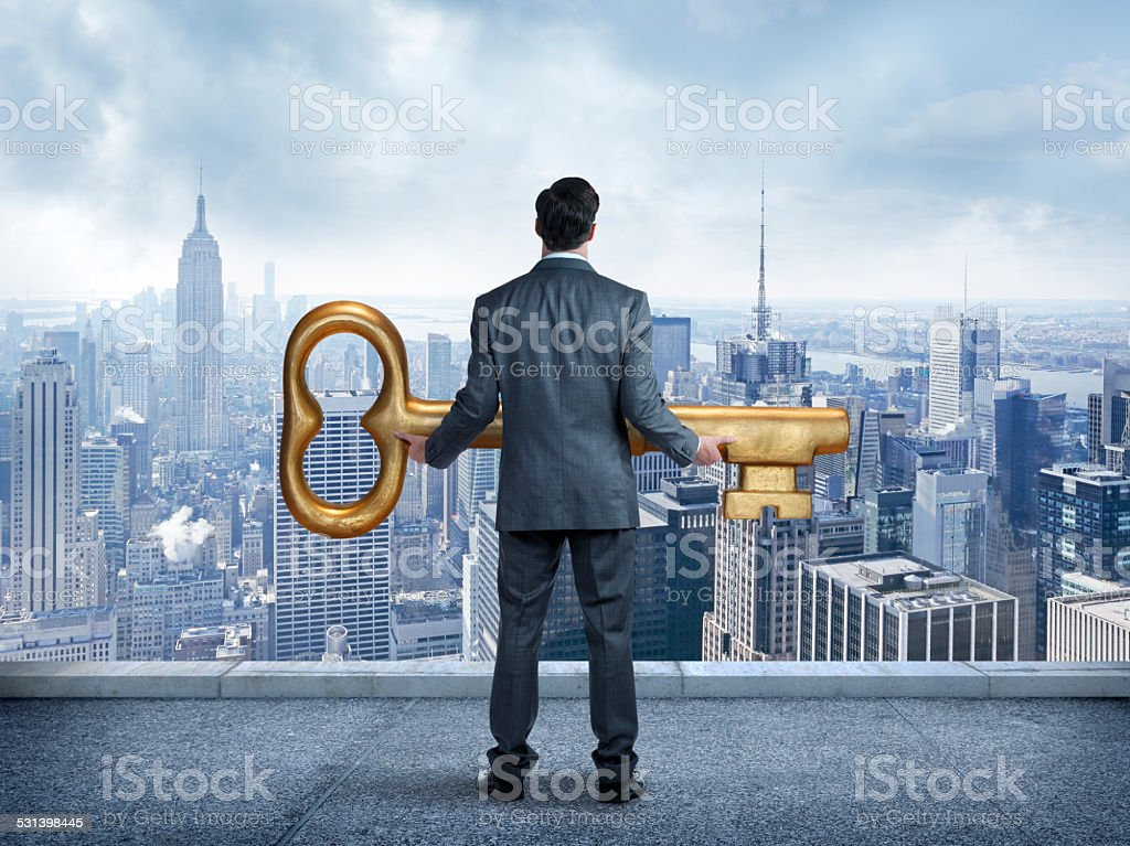 Businessman Holding The Key ToThe City stock photo