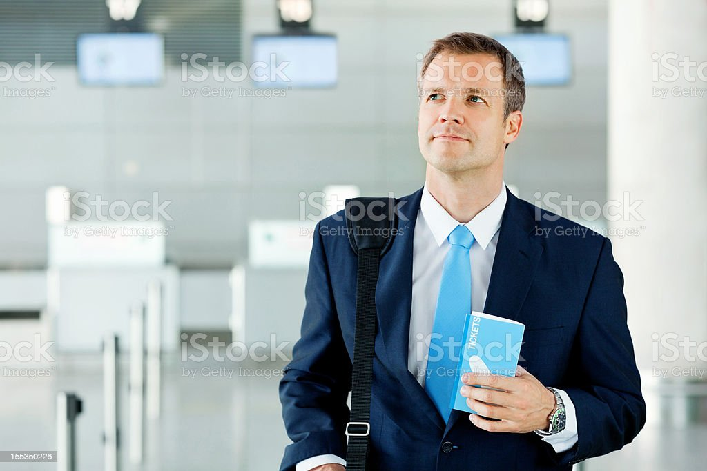 Businessman Holding Travel Tickets At Airport royalty-free stock photo