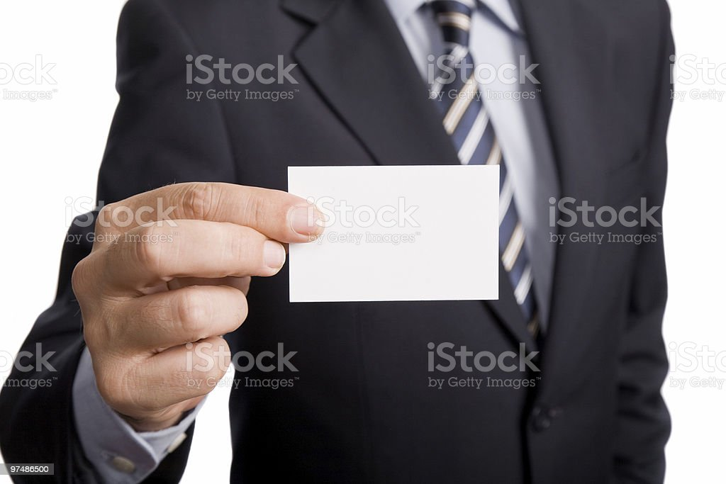 Businessman holding up a blank business card royalty-free stock photo