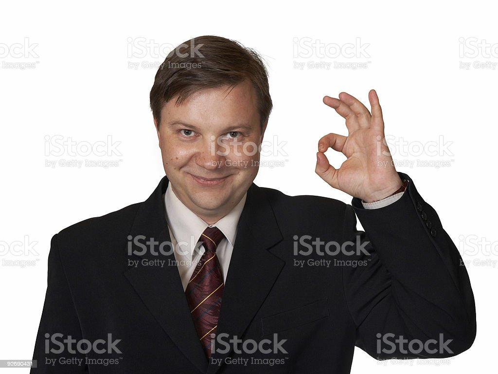 Businessman holding up an OK sign royalty-free stock photo