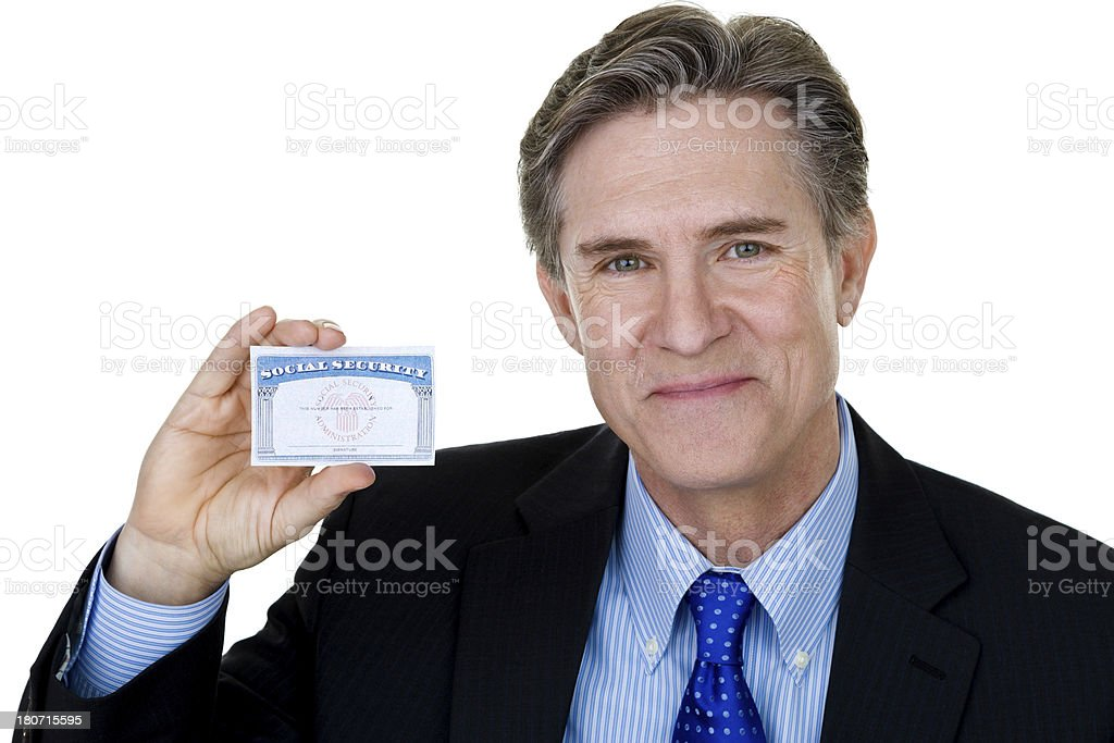 Businessman holding up card royalty-free stock photo