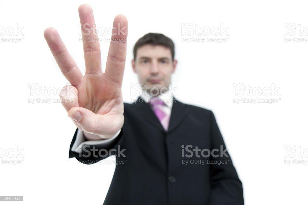 Businessman Holding Up Three Fingers stock photo