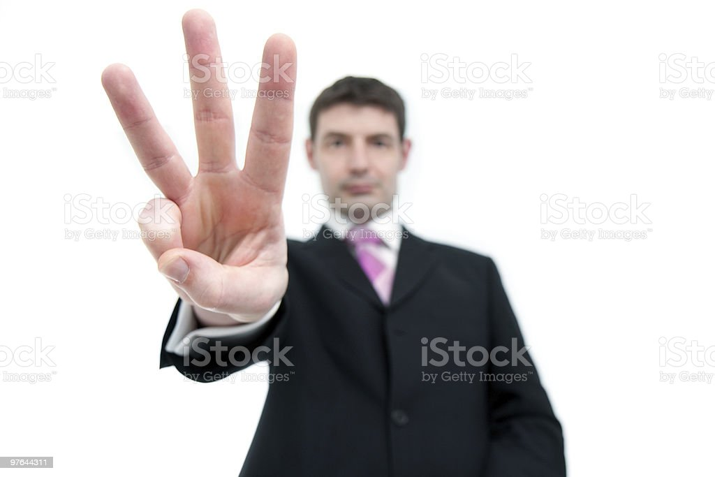 Businessman Holding Up Three Fingers stock photo