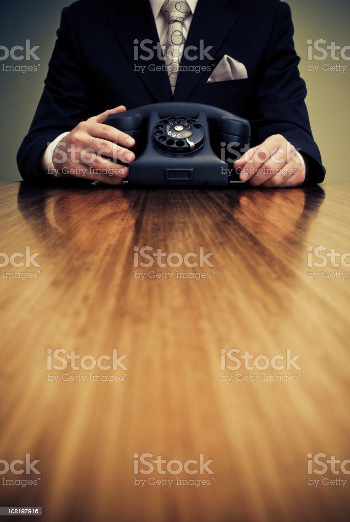 Businessman Holding Vintage Telephone royalty-free stock photo