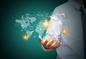 Businessman holding virtual world map