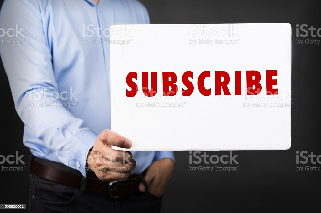 Businessman holding white board with SUBSCRIBE WORD stock photo