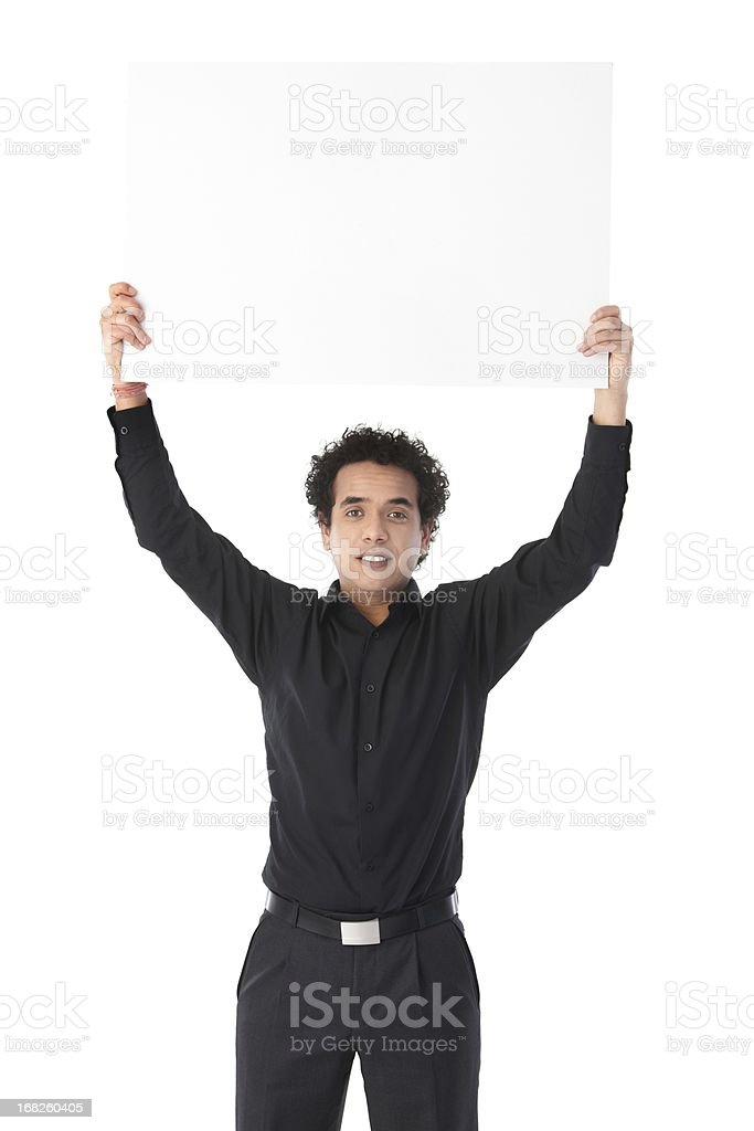 Businessman holding white placard royalty-free stock photo