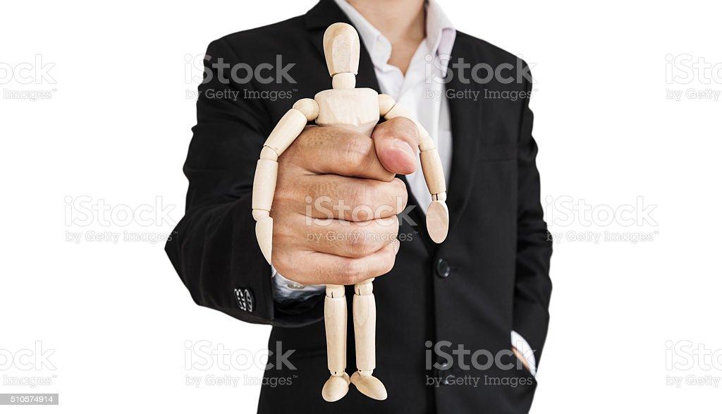 Businessman holding wooden figure, isolated on white background stock photo
