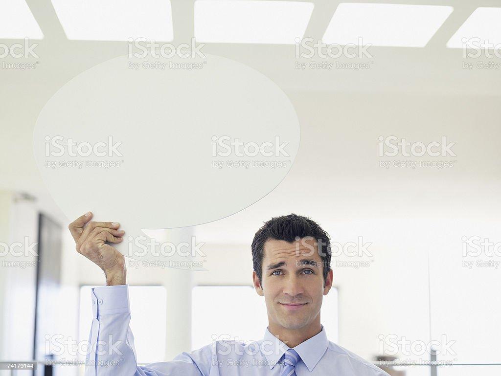 Businessman holding word balloon stock photo