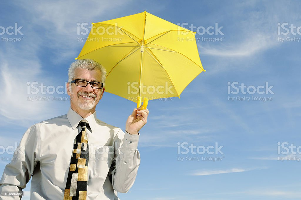 Businessman Holding Yellow Umbrella  Prepared For A Rainy Day stock photo
