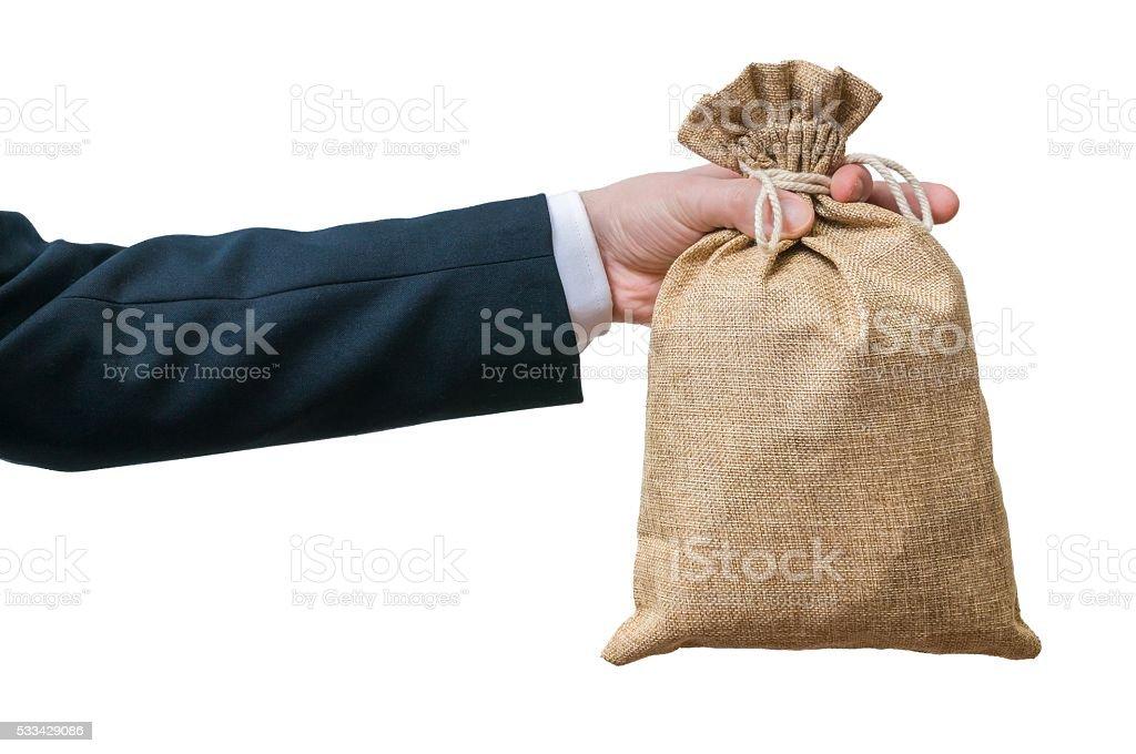 Businessman holds bag full of money. Isolated on white background. stock photo