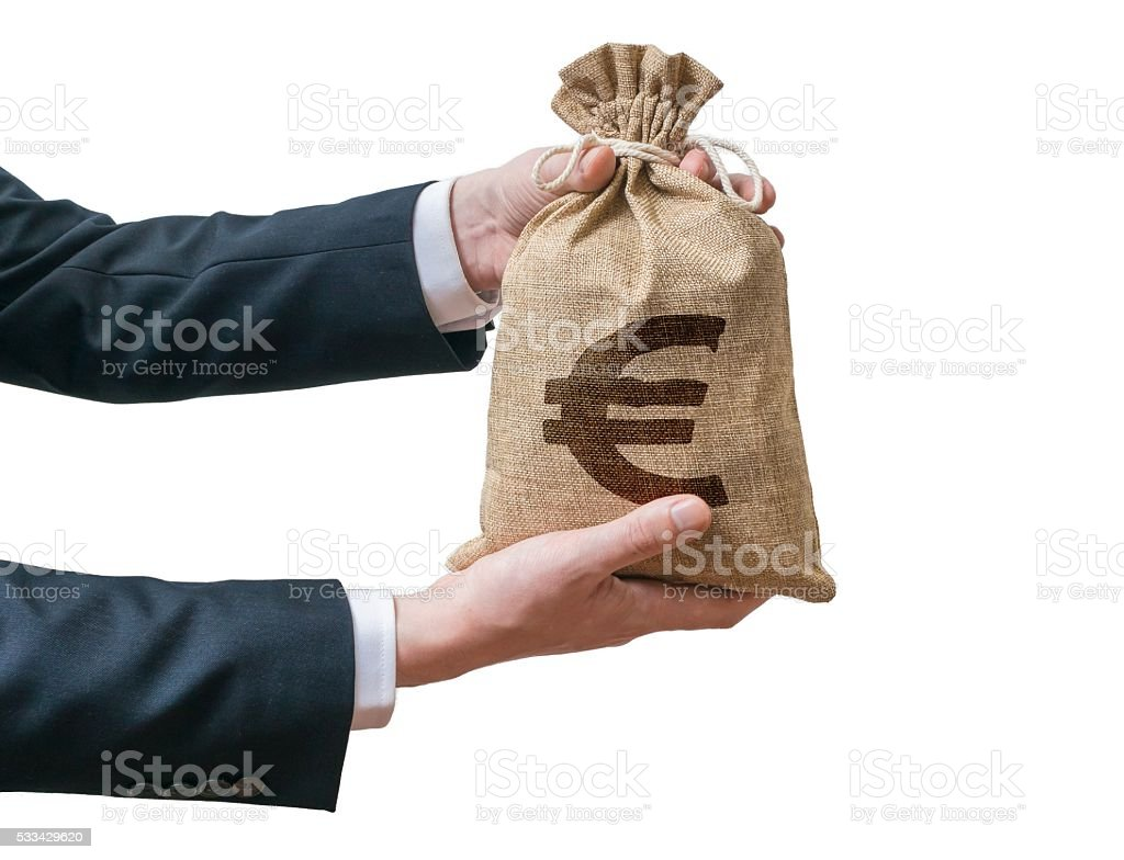 Businessman holds bag full of money with Euro sign. Isolated. stock photo