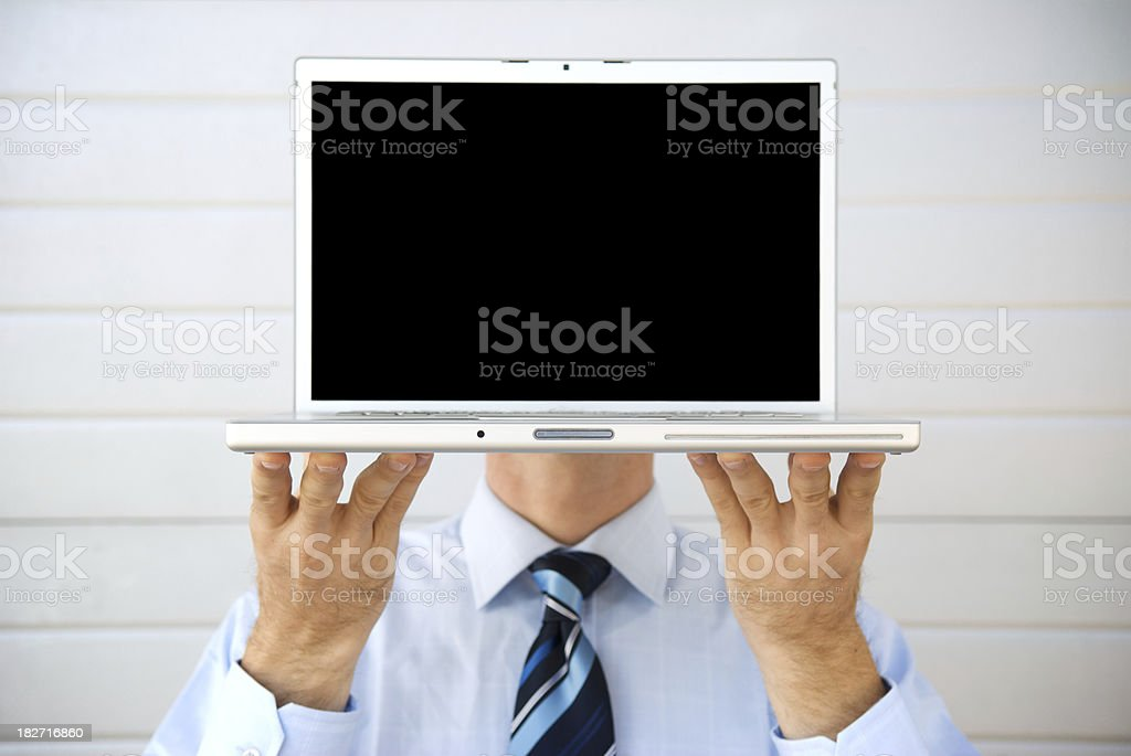 Businessman Holds Blank Laptop in front of Head royalty-free stock photo