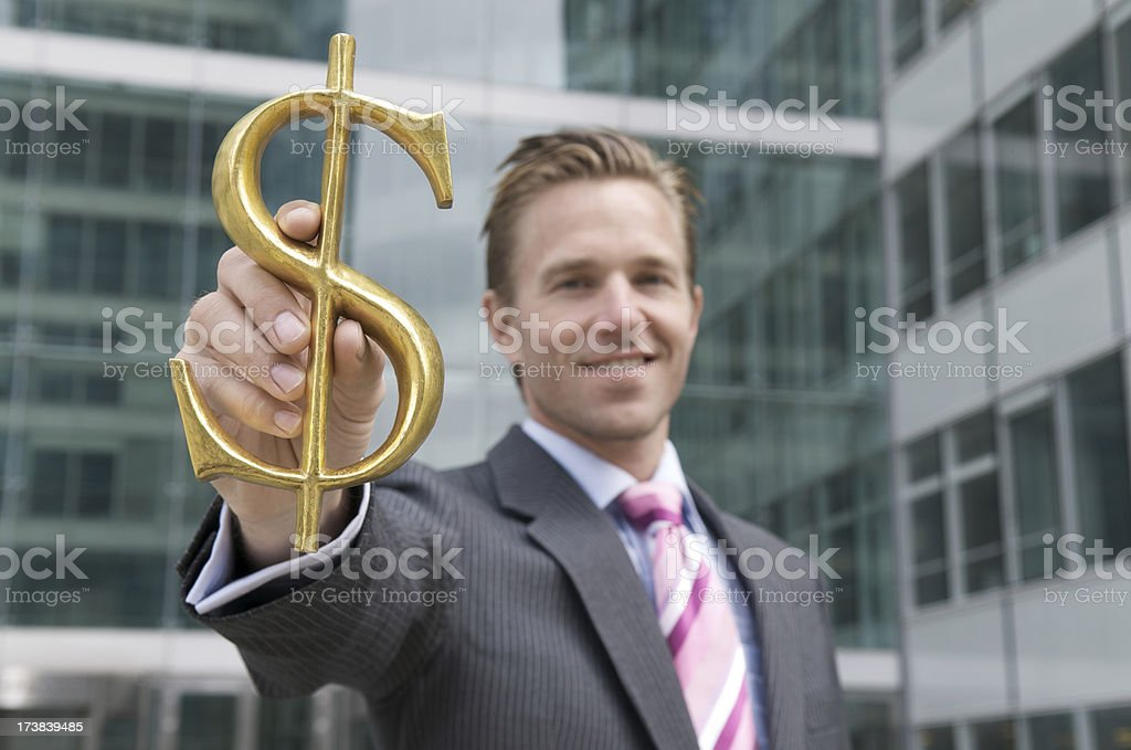 Businessman Holds Dollar Sign royalty-free stock photo