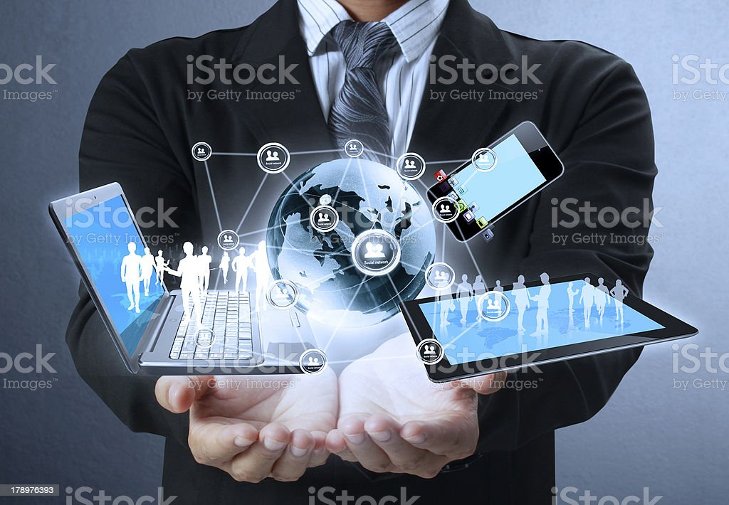 Businessman holds modern technology in hands stock photo