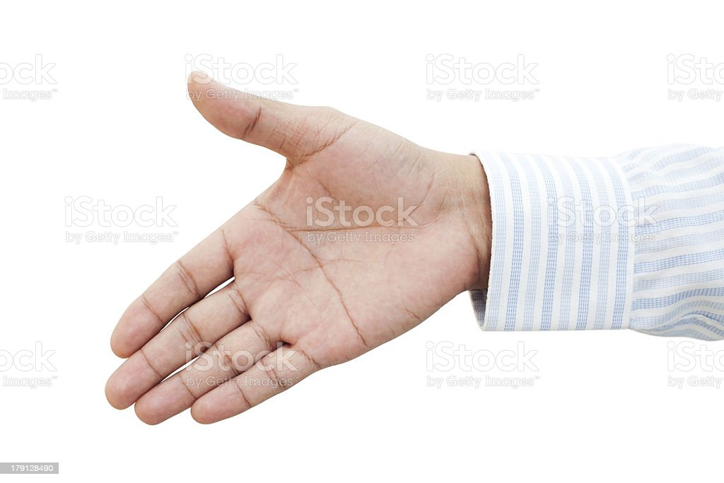 Businessman holds out his hand stock photo