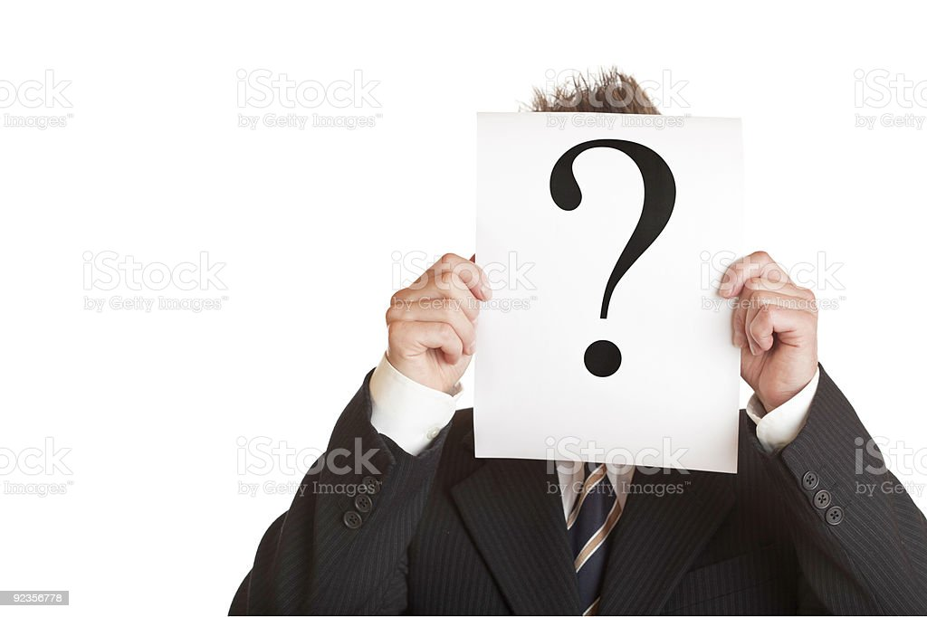 Businessman holds sign with a question mark royalty-free stock photo