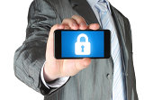 Businessman holds smart phone with closed lock