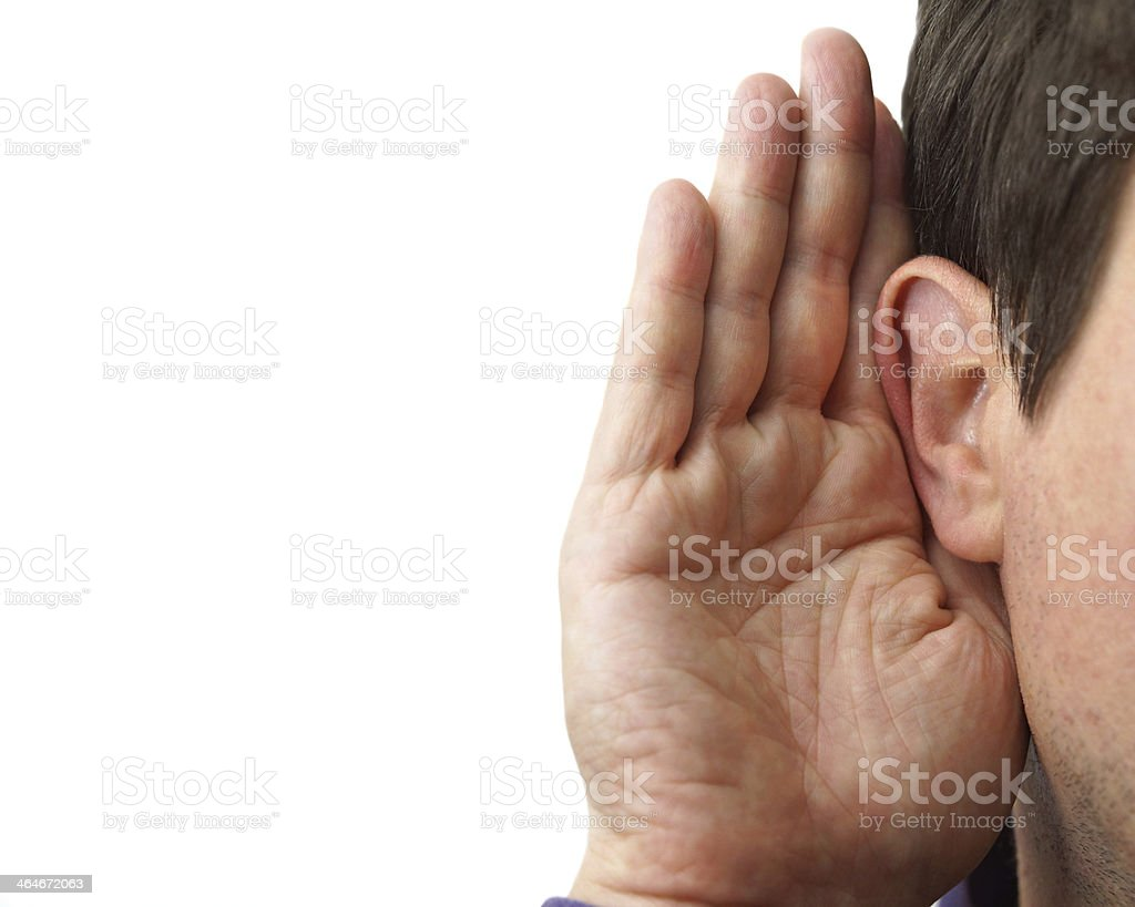Businessman holds the hand near his ear and listening stock photo