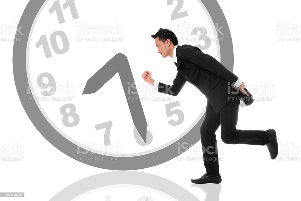 Businessman hurry to work at 8.30 am royalty-free stock photo