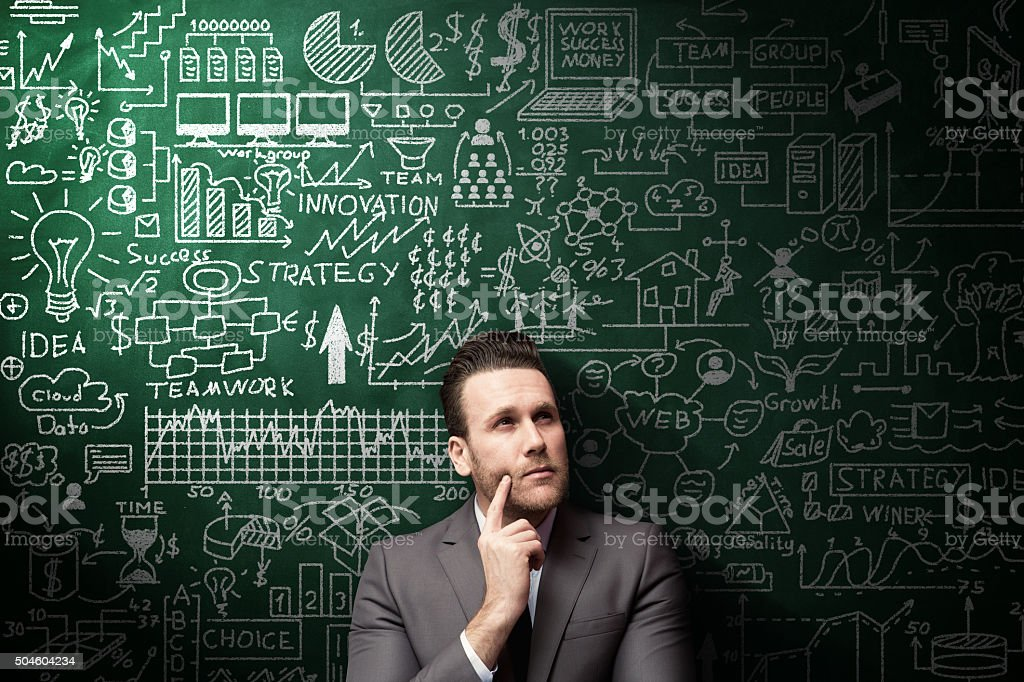 Businessman Idea Concept on blackboard stock photo