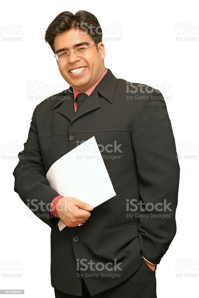 Businessman in a black suit holding pile of papers royalty-free stock photo