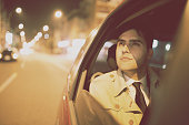 Businessman in a car at night
