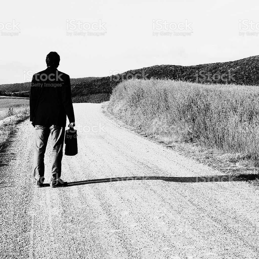 Businessman in a Country Road. Black And White. royalty-free stock photo