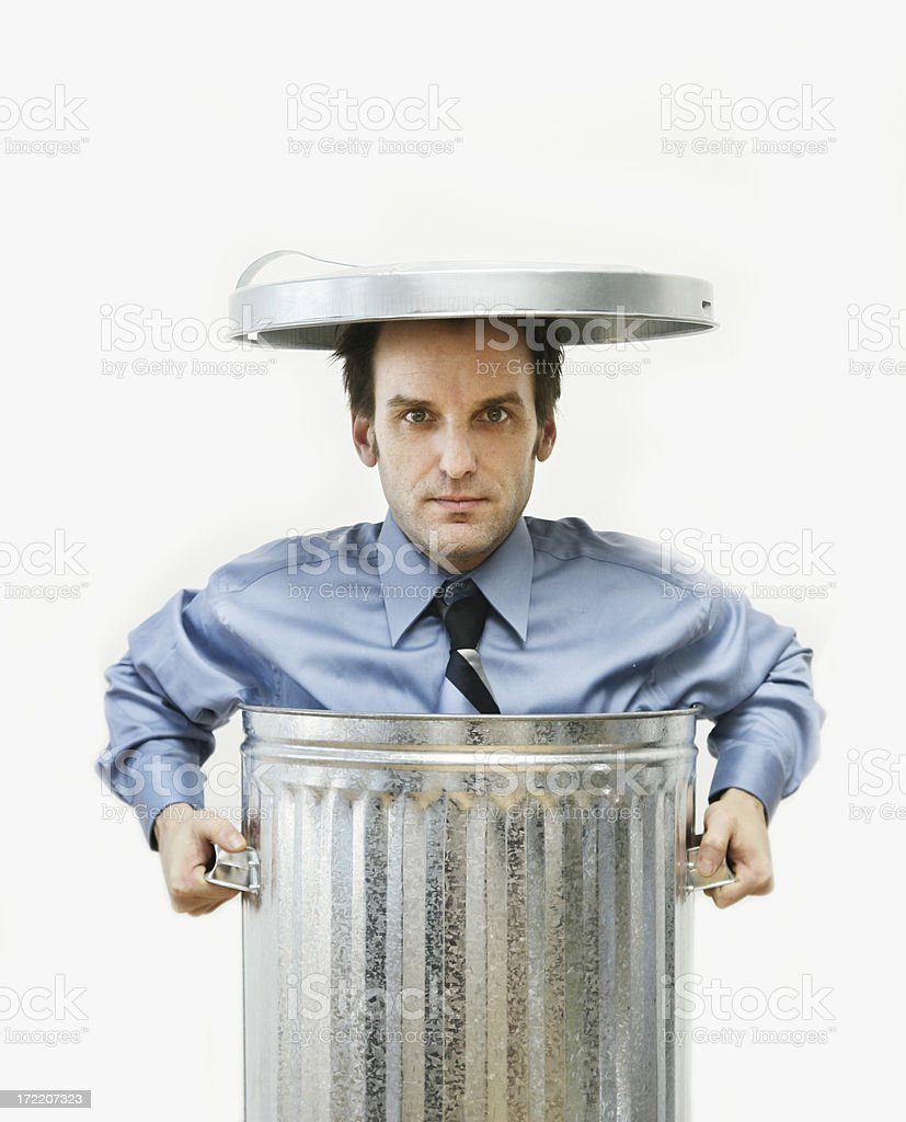 Businessman in a garbage can royalty-free stock photo