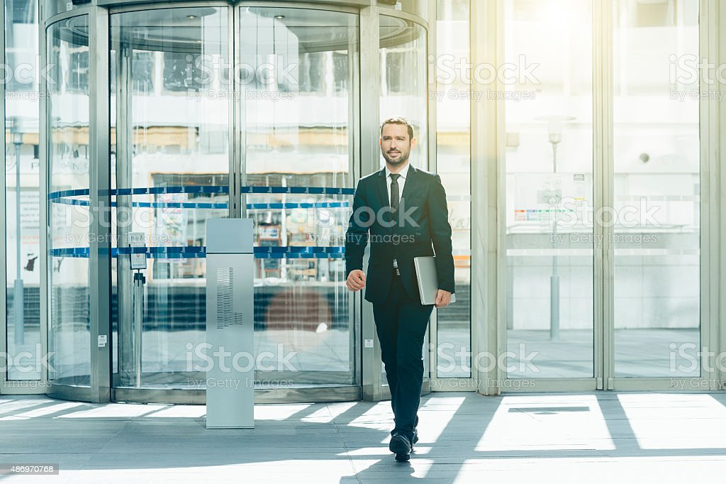 Businessman in a hall entrance stock photo